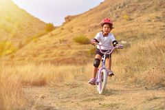 Free Happy Kid Girl Of 7 Years Having Fun In Autumn Park With A Bicycle On Beautiful Fall Day. Active Child Wearing Bike Helmet Stock Image - 165130991
