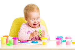 Happy kid girl playing with clay toy Stock Image