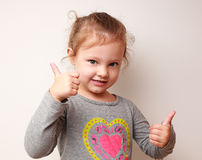 Happy kid girl showing thumbs up sign Royalty Free Stock Photo