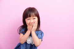 Happy kid girl smile. And think something isolated on pink background, asian Royalty Free Stock Photography