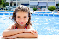 Happy kid girl smiling at swimming pool. In summer vacation royalty free stock image