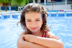Happy kid girl smiling at swimming pool. In summer vacation stock photos