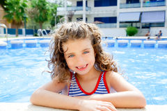 Happy kid girl smiling at swimming pool Royalty Free Stock Photos