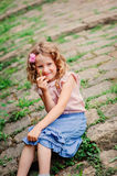 Happy kid girl on the walk in old city at stone wall Royalty Free Stock Photography