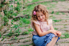 Happy kid girl on the walk in old city at stone wall Royalty Free Stock Image