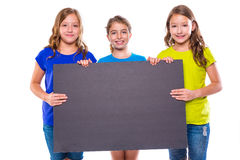 Happy kid girls holding black board copyspace Stock Photography