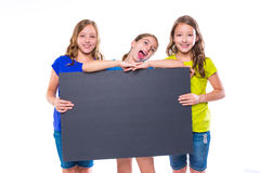 Happy kid girls holding black board copyspace Stock Photos