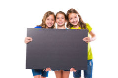 Happy kid girls holding black board copyspace. On white background Stock Photos