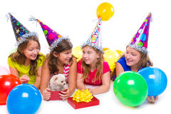 Happy kid girls puppy dog gift in birthday party Stock Photography