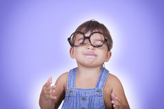 Happy kid in glasses enjoying something with eyes closed Royalty Free Stock Photography