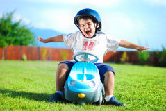 Happy kid on green meadow Stock Image