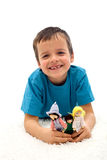 Happy kid grinning with missing tooth. Happy kid with missing tooth playing on the floor grinning - isolated Royalty Free Stock Image