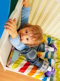 Happy kid hands on bed Stock Image