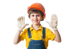 Happy kid in hardhat stands with open palms Royalty Free Stock Images