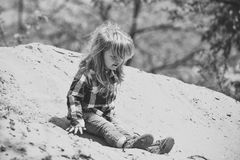 Happy kid having fun. Toddler slide from pile of sand on idyllic sunny day. Happy kid having fun. Childhood. Toddler slide from pile of sand on idyllic sunny day Royalty Free Stock Images