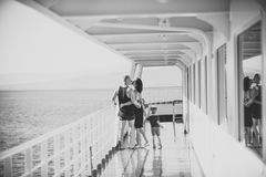 Happy kid having fun. Family travelling on cruise ship on sunny day. Family and love concept. Father, mother and child. Stand on deck of cruise liner with sea royalty free stock photography