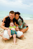 Happy kid and his parents. At the coastline Stock Images