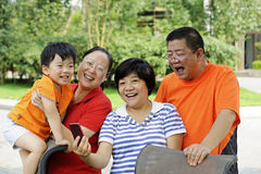 Happy kid with his uncle and aunt royalty free stock photo