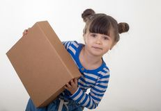 Happy kid holding cardboard boxes, delivery of goods, isolated over white. Internet purchases stock images