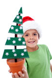 Happy kid holding christmas decoration Stock Photos
