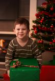 Happy kid holding christmas present Royalty Free Stock Photo