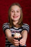Happy Kid holding a cupcake Stock Images