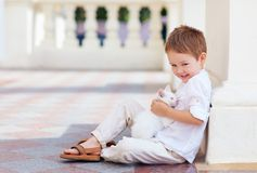 Happy kid holding cute white cat Royalty Free Stock Photo