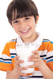 Happy kid holding a glass of milk Stock Photo