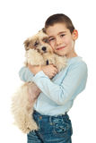 Happy kid holding his puppy Royalty Free Stock Image