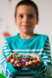 Happy kid holding loom bands Stock Photography