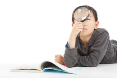 Happy kid is holding magnifying glass to explore. Over white royalty free stock images