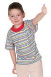 Happy kid holding thumb up Stock Photo