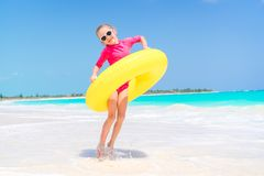 Happy kid with inflatable rubber circle having fun on the white beach. Happy child with inflatable rubber circle having fun on the beach Stock Photo