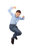 Happy kid jumping for joy. Isolated on white background Royalty Free Stock Photography