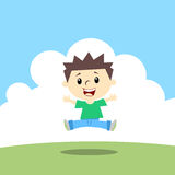 Happy kid. Jumping in landscape Royalty Free Stock Photography