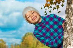 Happy kid jumping out of tree Stock Photos