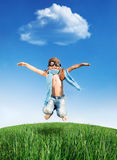 Happy kid jumping outdoors Royalty Free Stock Photography