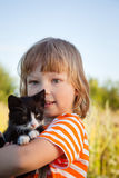 Happy kid with a kitten Stock Image