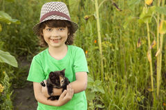 Happy kid with a kitten Royalty Free Stock Images