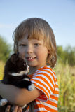 Happy kid with a kitten Royalty Free Stock Image