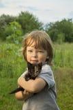 Happy kid with a kitten Stock Photo