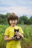 Happy kid with a kitten Royalty Free Stock Photo
