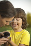 Happy kid with a kitten Stock Photography