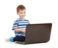 Happy kid with laptop on white background Stock Images