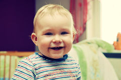 Happy kid laughing looking at the camera Stock Photography