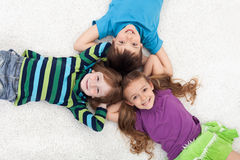 Happy kid laying on the floor Royalty Free Stock Photo