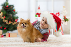 Happy kid little boy and dog at Christmas Stock Photo