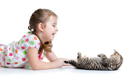 Happy kid lying on floor and playing with kitten Royalty Free Stock Photo