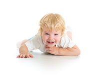 Happy kid lying on floor. Happy kid lying on white floor Stock Photos