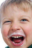 Happy kid with milky face stock image